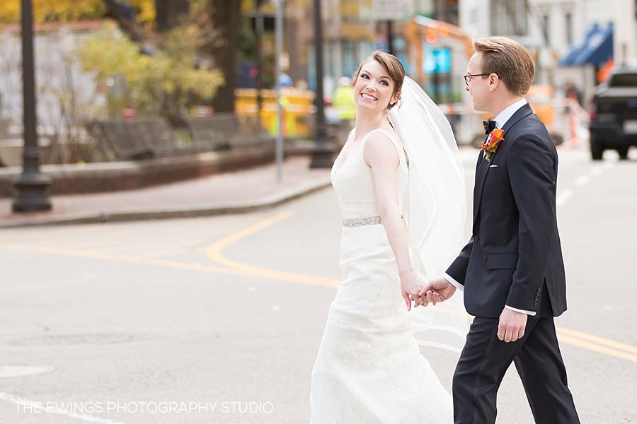 A picture of a bride and groom in downtown Boston for their fall wedding at The State Room a Longwood Events venue.