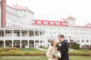 best omni mount washington wedding photographer and videographers with couple behind the grand hotel