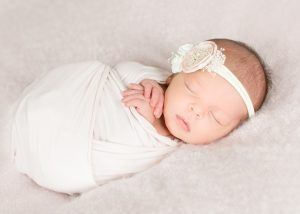 Newborn photography studio in bolton ma provides styled posed newborn photography and lifestyle family portraits