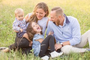 fun sterling ma family portrait session outside during evening light in a field