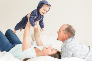 indoor family portraits in the white room at the Ewings photography studio