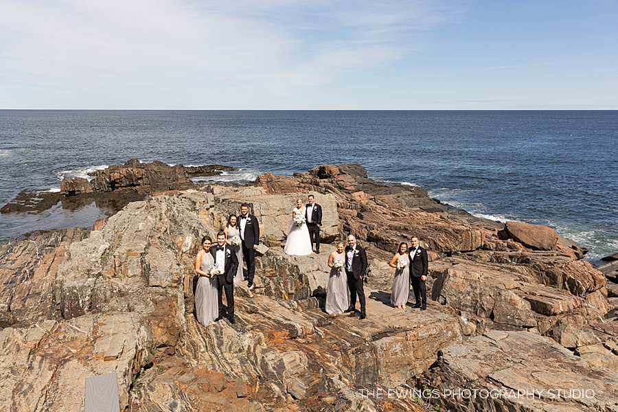 wedding party portrait on the cliffs in maine