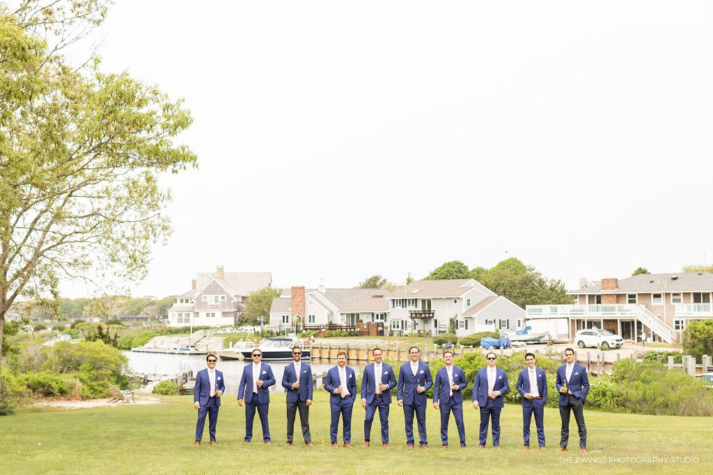 Falmouth wedding photographer works with Cape Cod wedding party for portraits by bay
