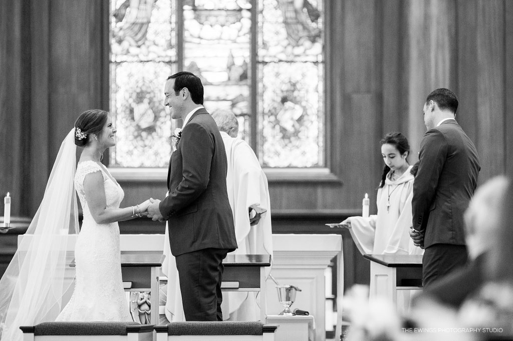 Wedding ceremony at Christ the King in Falmouth where bride & groom exchange rings