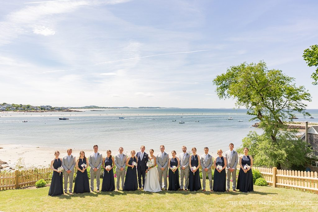 Here's a wedding party portrait at Annisquam Harbor by the Gloucester MA wedding photography & videography team The Ewings.