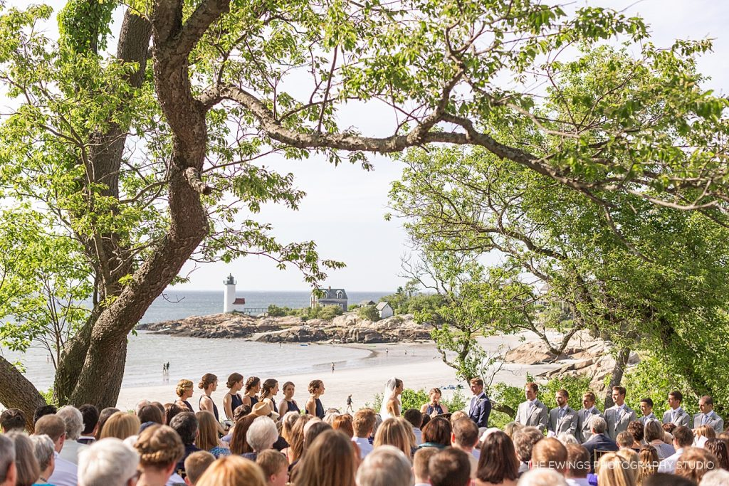 Here's an outdoor wedding ceremony in Gloucester MA with views of the beach and Annisquam Harbor / Lighthouse.