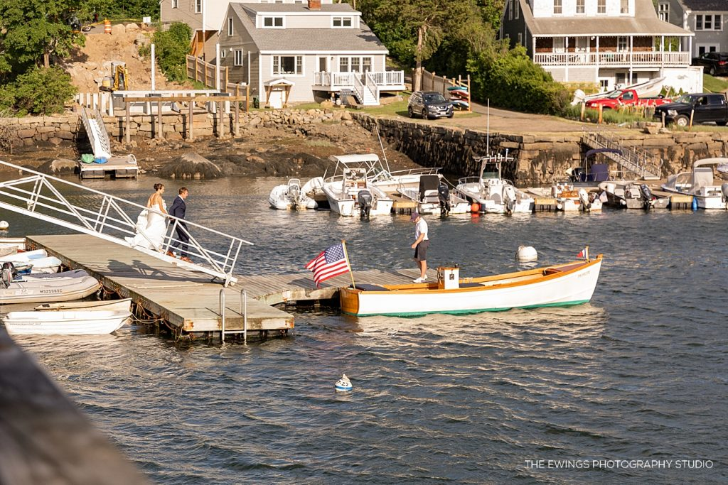 Bride and groom take a boat to cocktail hour, photographed by The Ewings Photography Studio in Gloucester MA.