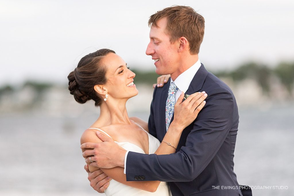 A bride and groom at their Annisquam Yacht Club wedding in Gloucester MA, a beautiful North Shore location for their wedding venue.