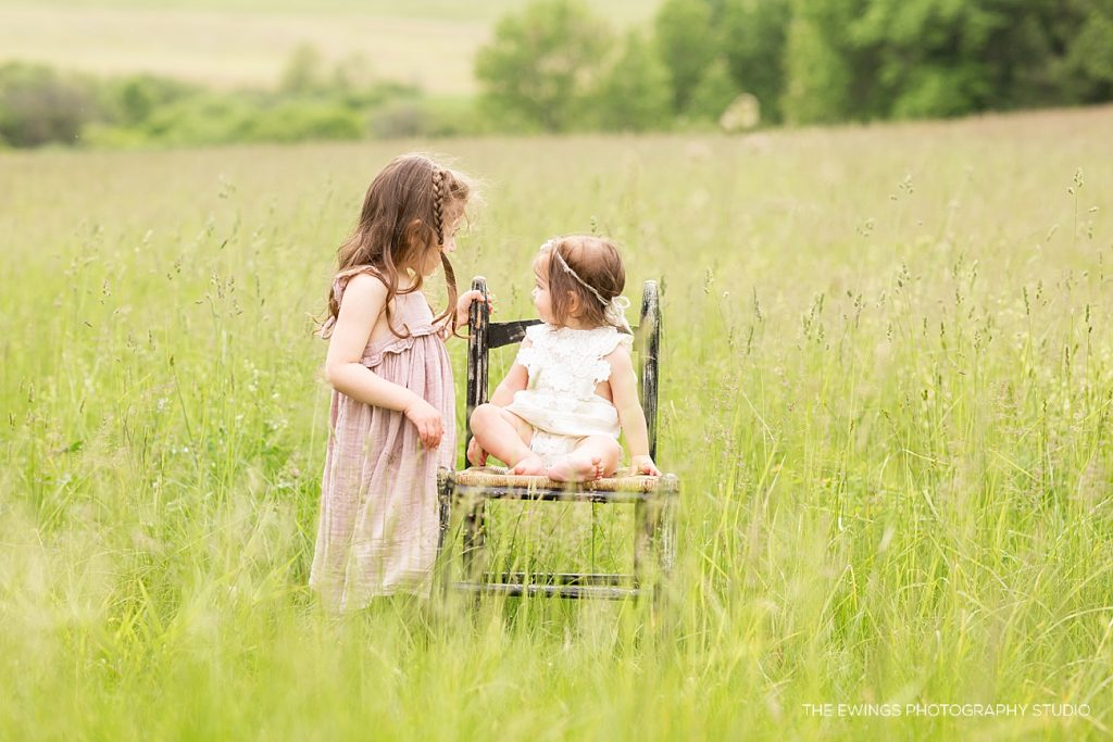 A portrait session with two young sisters in a field in Sterling MA.