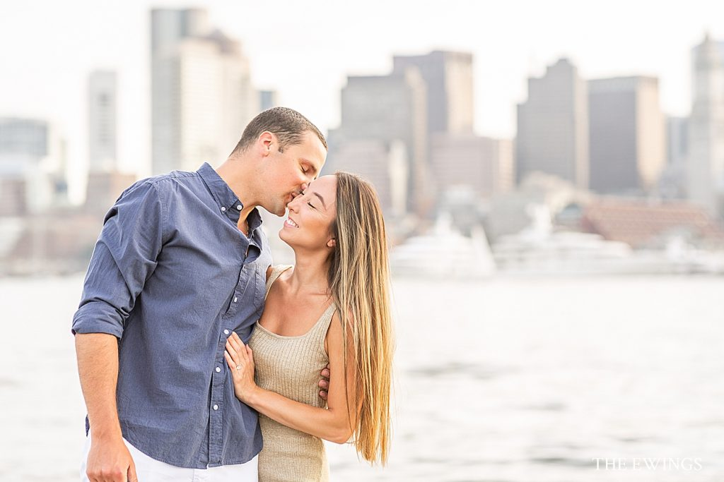 This blog post features an east boston engagement session with a newly engaged couple. This area of East Boston has the best Boston skyline views!