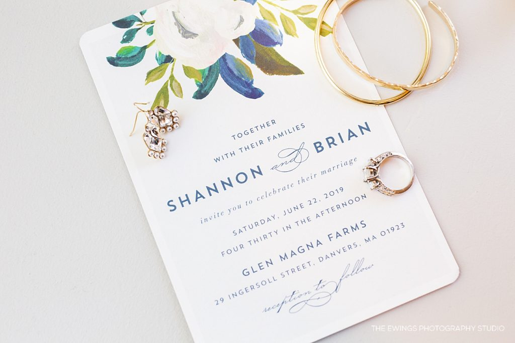 Shannon & Brian were married at Glen Magna Farms in Danvers. Here is a picture of their wedding invitation & her jewelry, taken at Hotel Salem by The Ewings Photography Studio