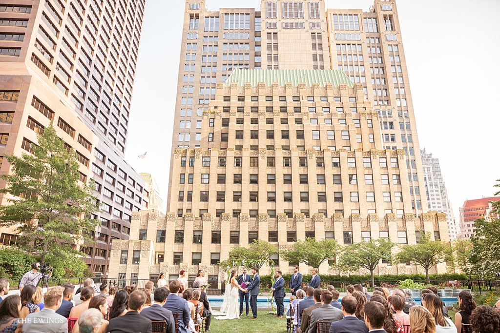 Here is a rooftop wedding ceremony in Boston at 9OFS, a unique garden venue in downtown Boston.