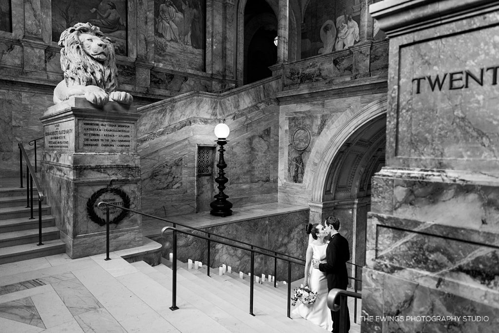 A Boston Public Library with bride and groom portraits on the iconic staircase.