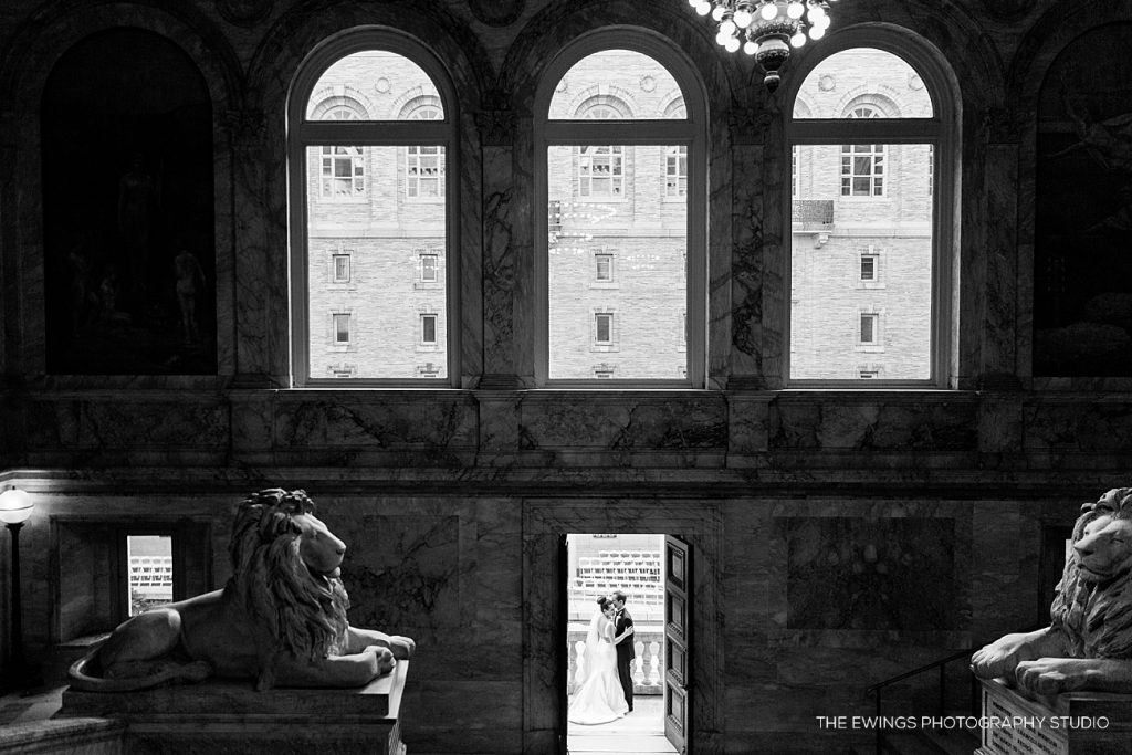 A dramatic portrait of a bride and groom before their Boston Public Library wedding ceremony in the courtyard.