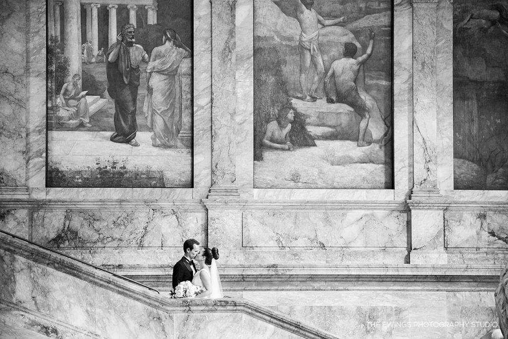 A breathtaking picture of the bride and groom at the Boston Public Library indoors before their jewish ceremony.