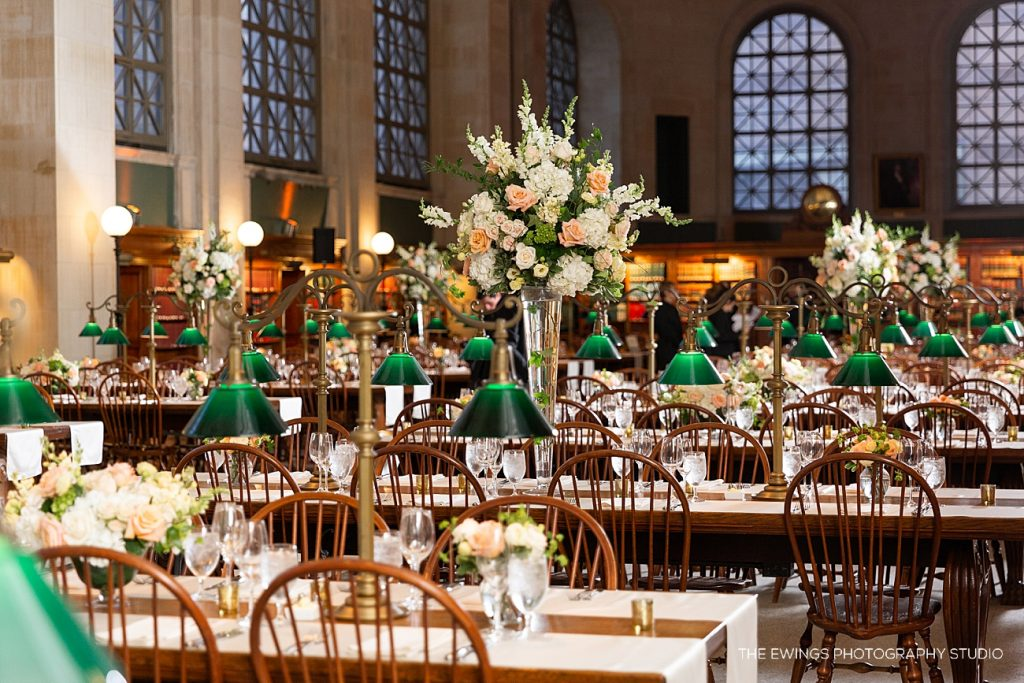 Tables set for an elegant black tie wedding at the Boston Public Library in Bates Hall.