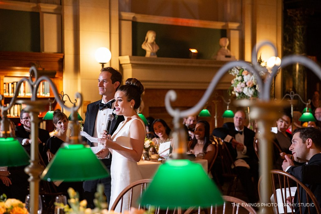 A bride and groom give a warm-hearted thank you speech at their wedding reception at the Boston Public Library.