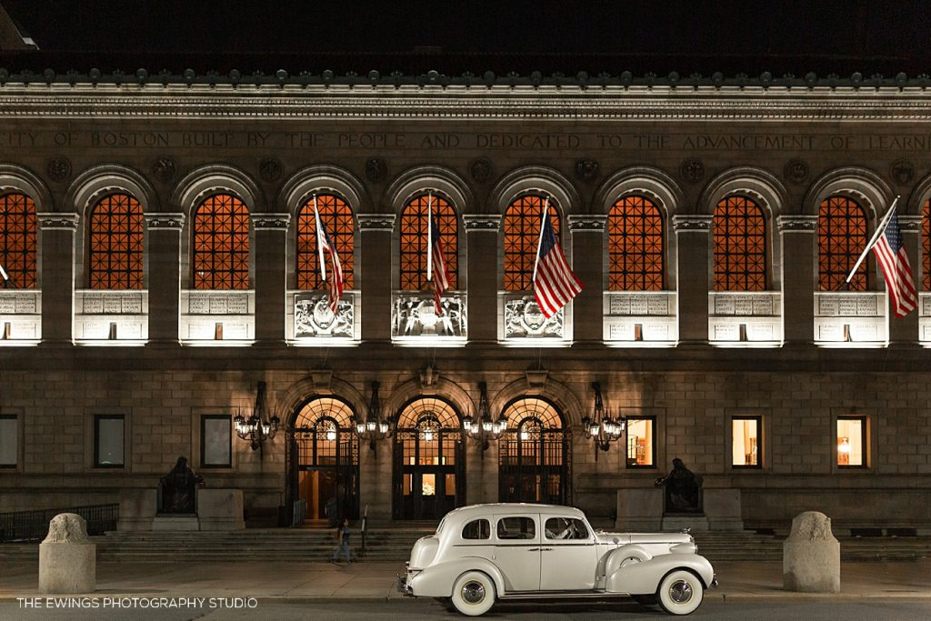 A vintage getaway car awaits the bride and groom outside the Boston Public Library where their black tie wedding venue was.