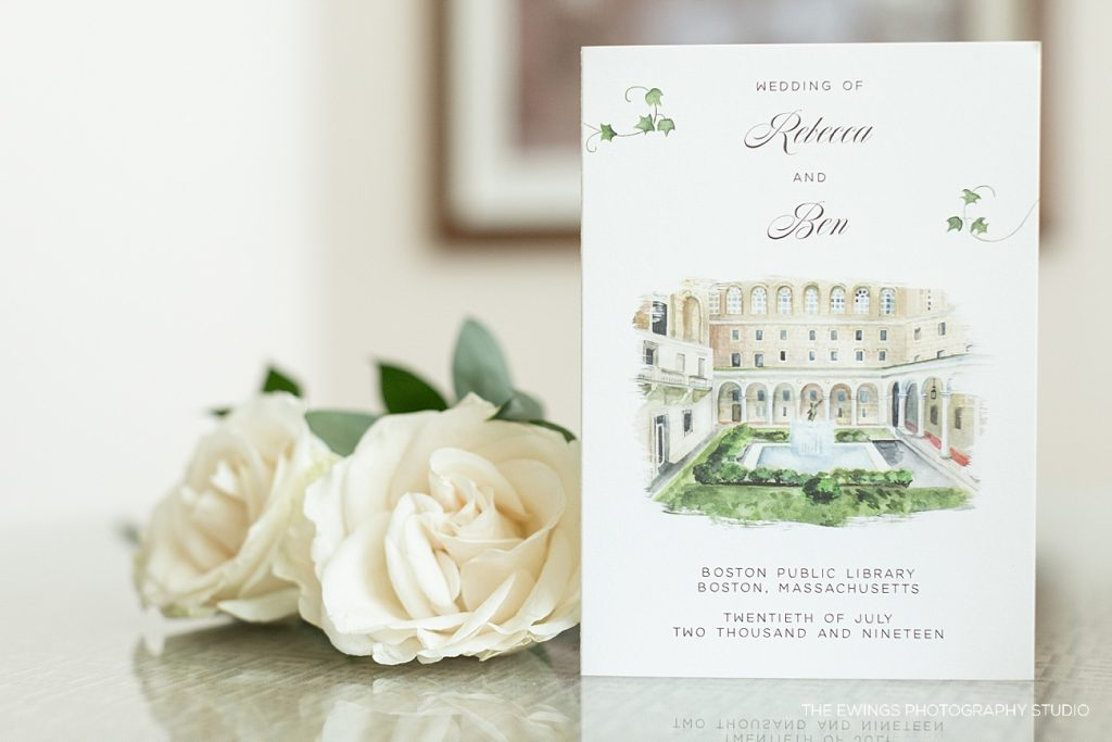 A wedding invitation photographed by The Ewings in the Ritz Carlton Boston penthouse.