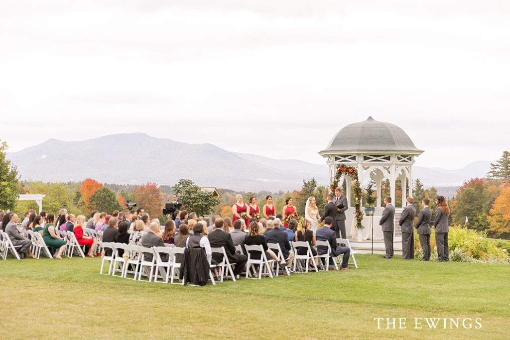 An outdoor wedding ceremony at the Mountain View Grand gazebo with views of the White Mountains in the background.