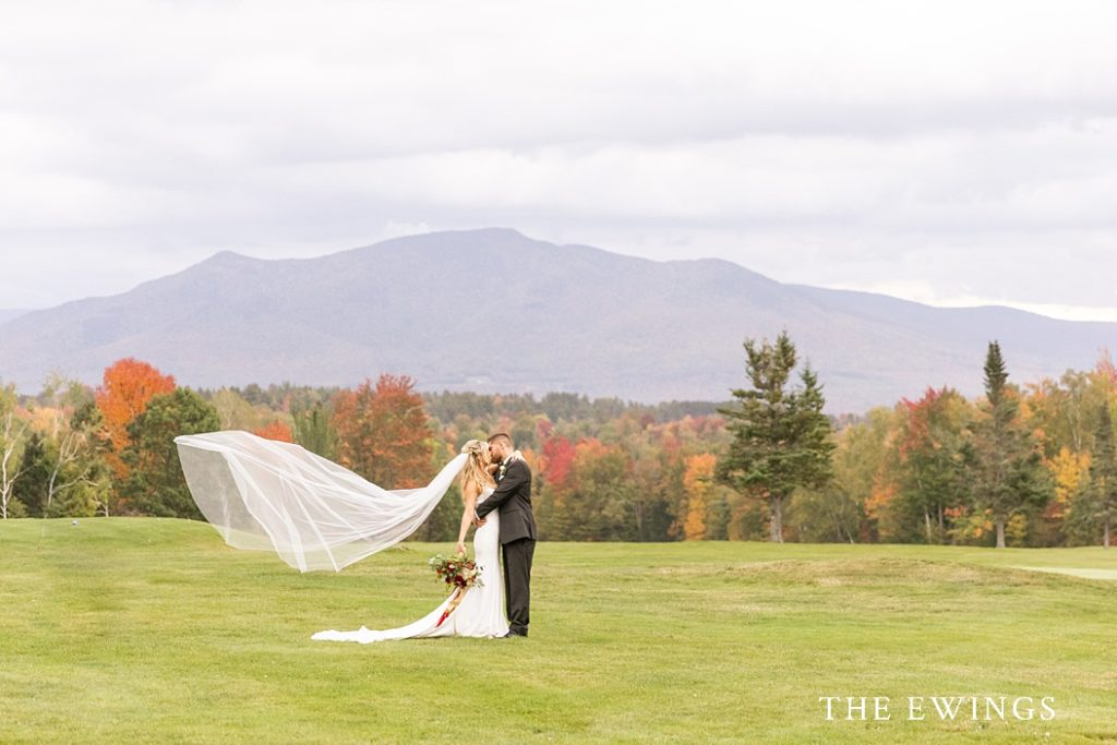 An epic bride and groom portrait with the White Mountains in the background.