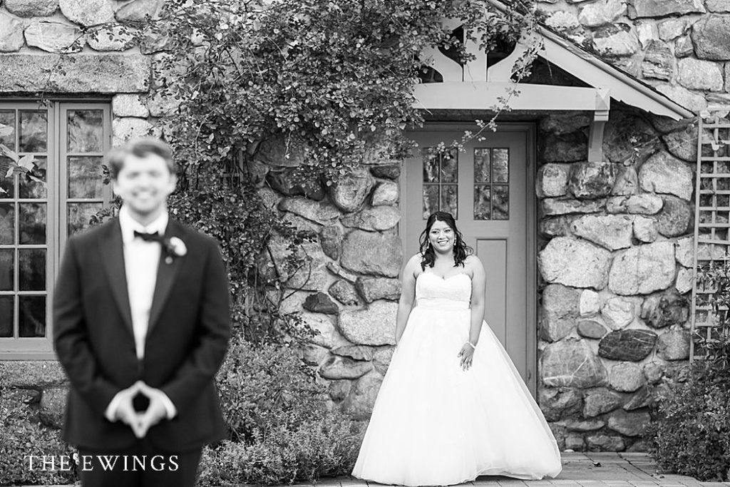 A dramatic picture of a bride and groom first look at a mansion wedding venue.