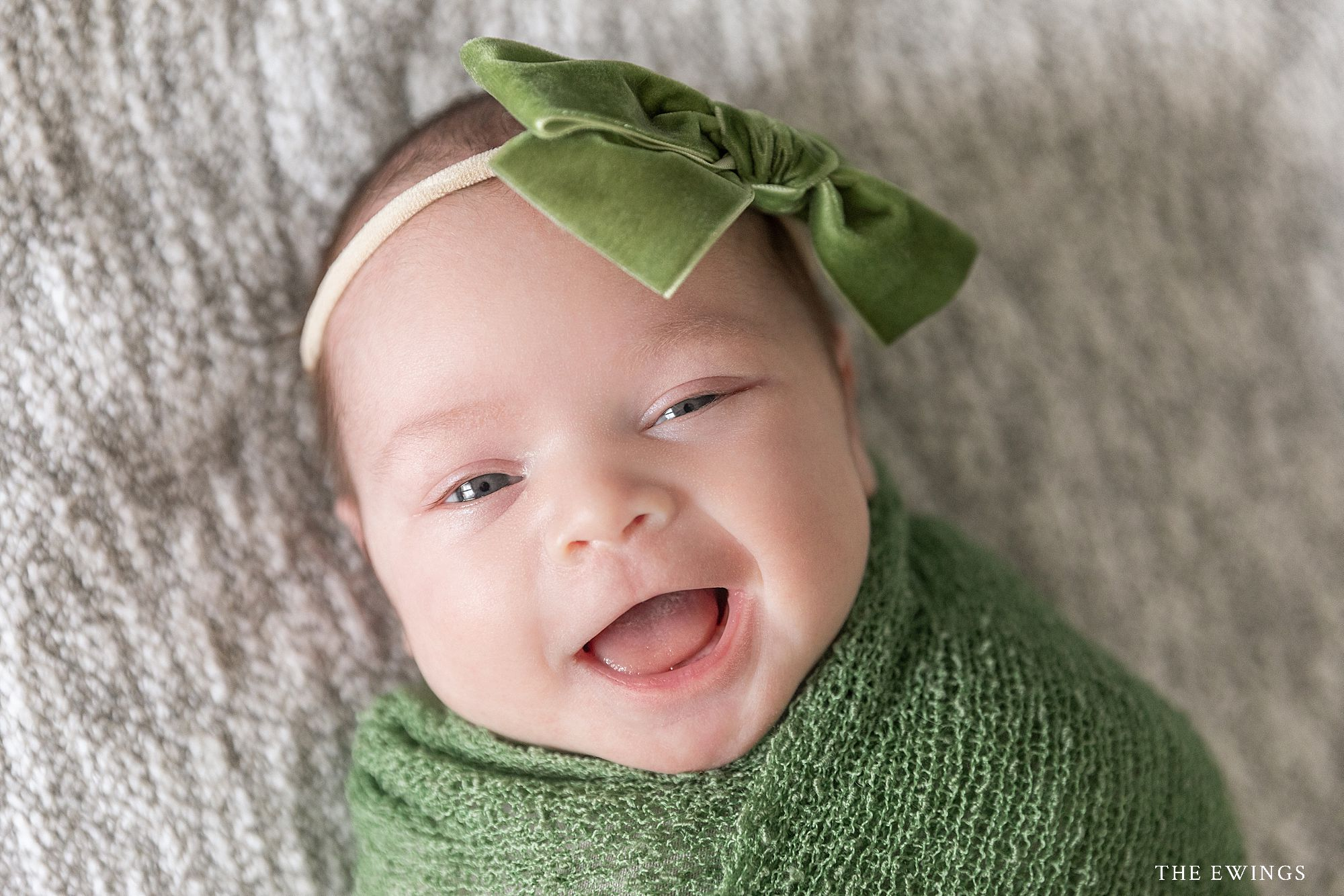 Big belly laughs during at Newborn Session at The Ewings, a portrait photography studio in North Central Massachusetts.