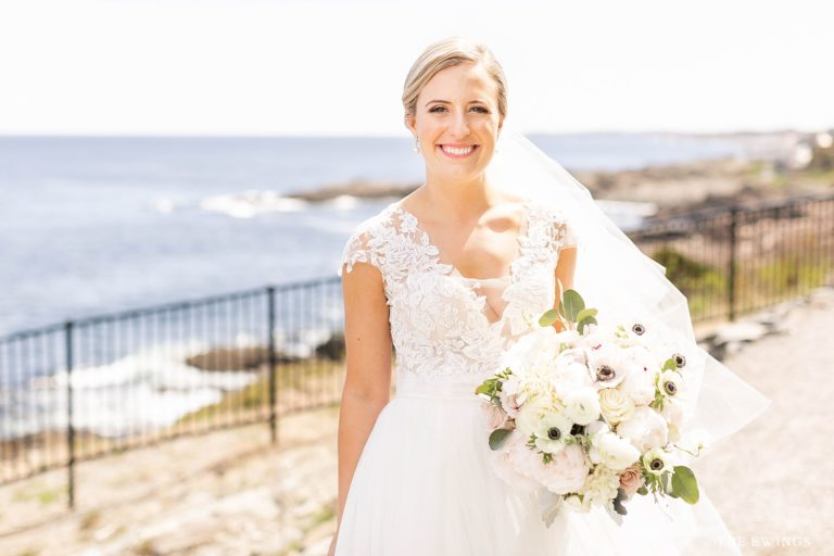 A bride by the cliffs at Cliff House in Ogunquit Maine on her wedding day, photographed by The Ewings Photography Studio.