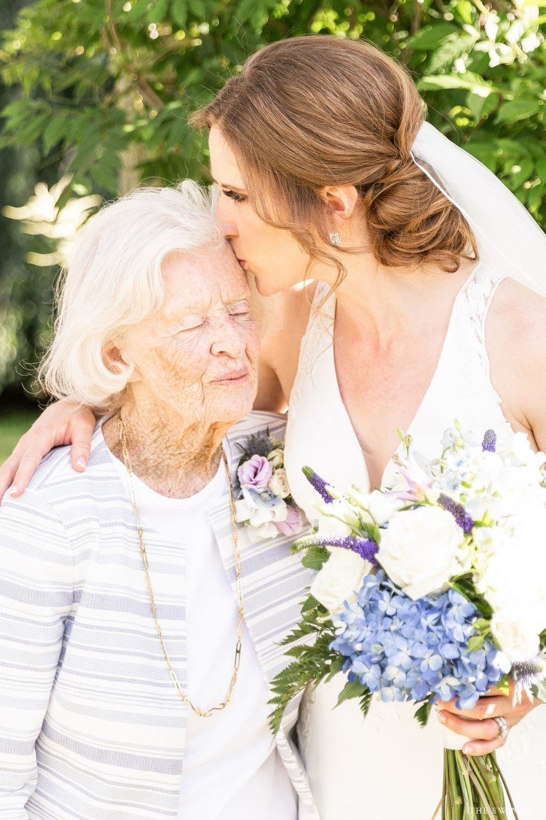 A sweet moment between a bride and her grandmother at Glen Magna Farms in Danvers MA.