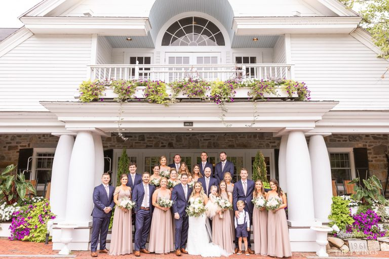 A wedding party picture on the front steps of Church Falls in Meredith NH on their wedding day.
