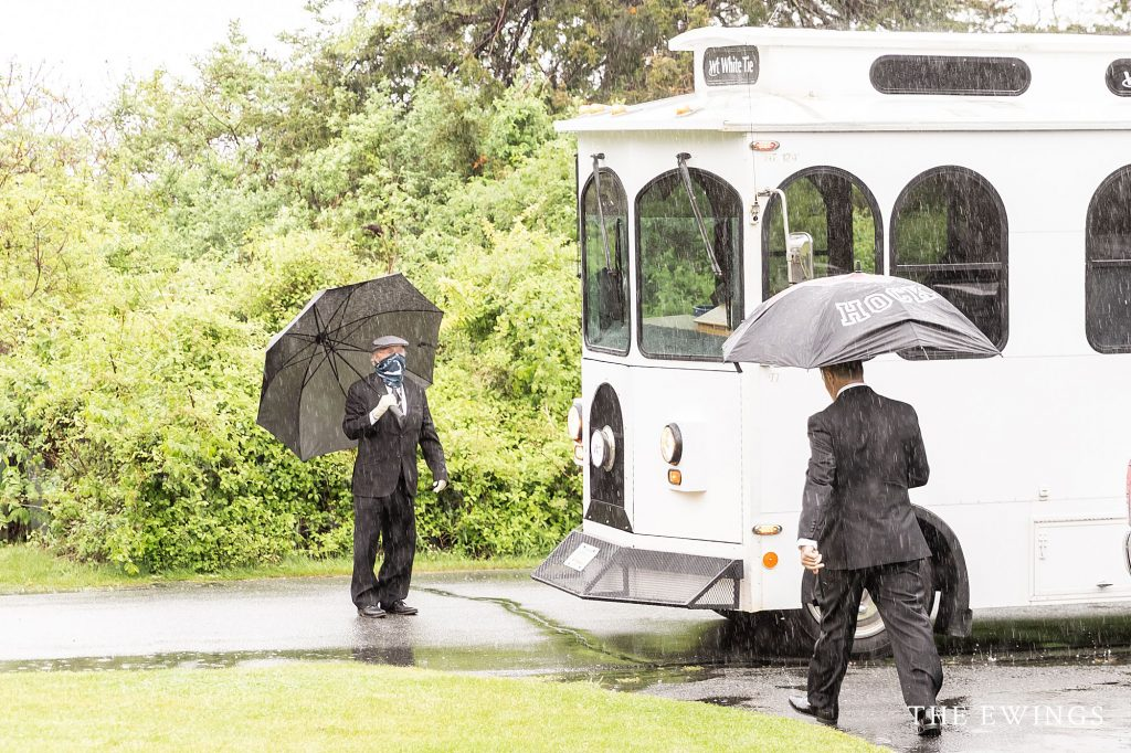 Cape Cod trolley on a rainy day for this A bride getting ready at a private residence for her intimate wedding elopement in Falmouth MA