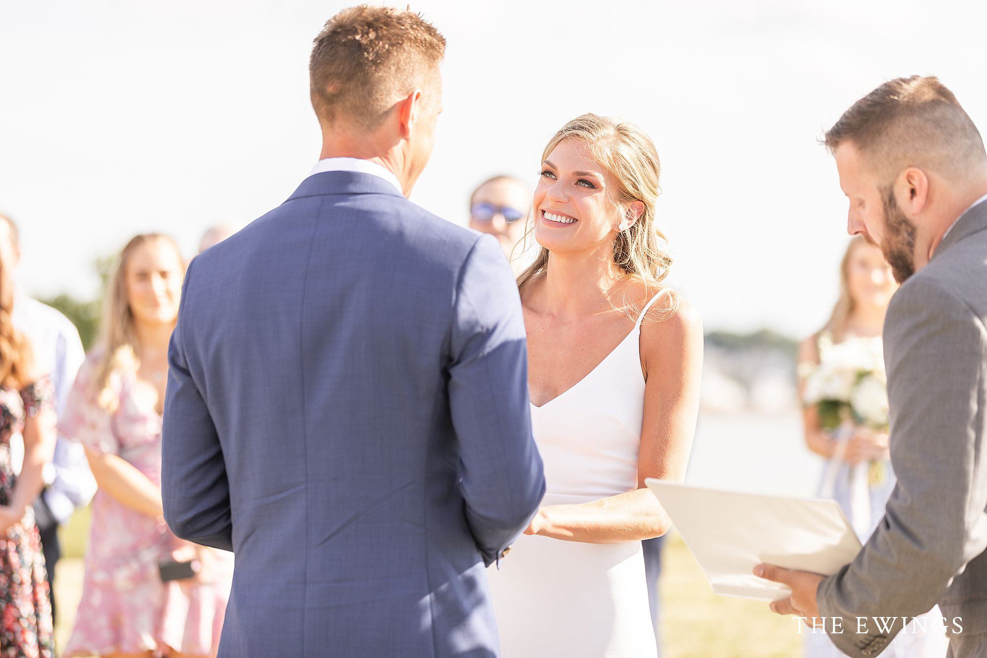 A bride and groom getting married during their intimate Boston Harbor Island wedding on Nut Island.