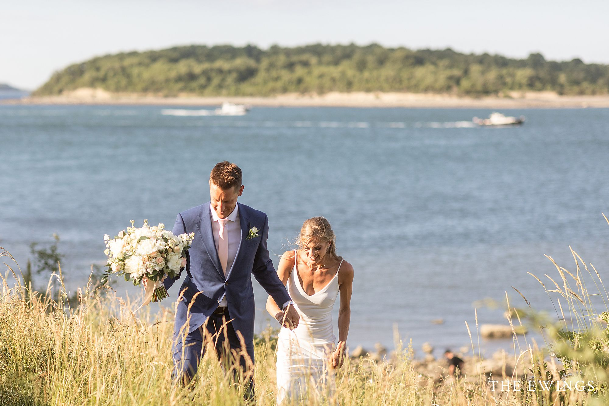 Bride and groom and views of the Boston Harbor Islands after their intimate micro wedding ceremony on Nut Island in Quincy.