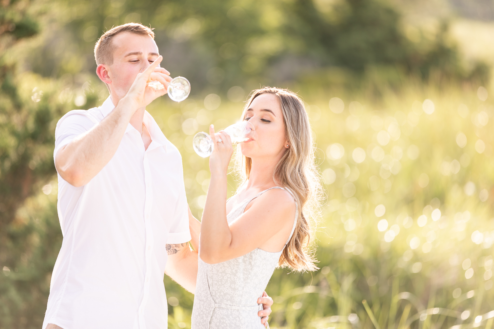 Champagne on the beach engagement session on the North Shore Boston.
