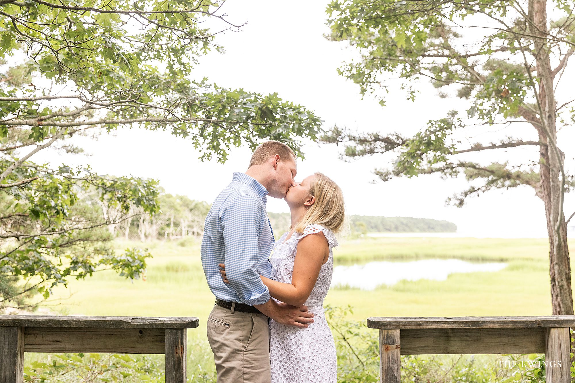 A bride and groom in Cotuit in MA after their Cape Cod elopement wedding ceremony, with light and airy pictures by The Ewings.