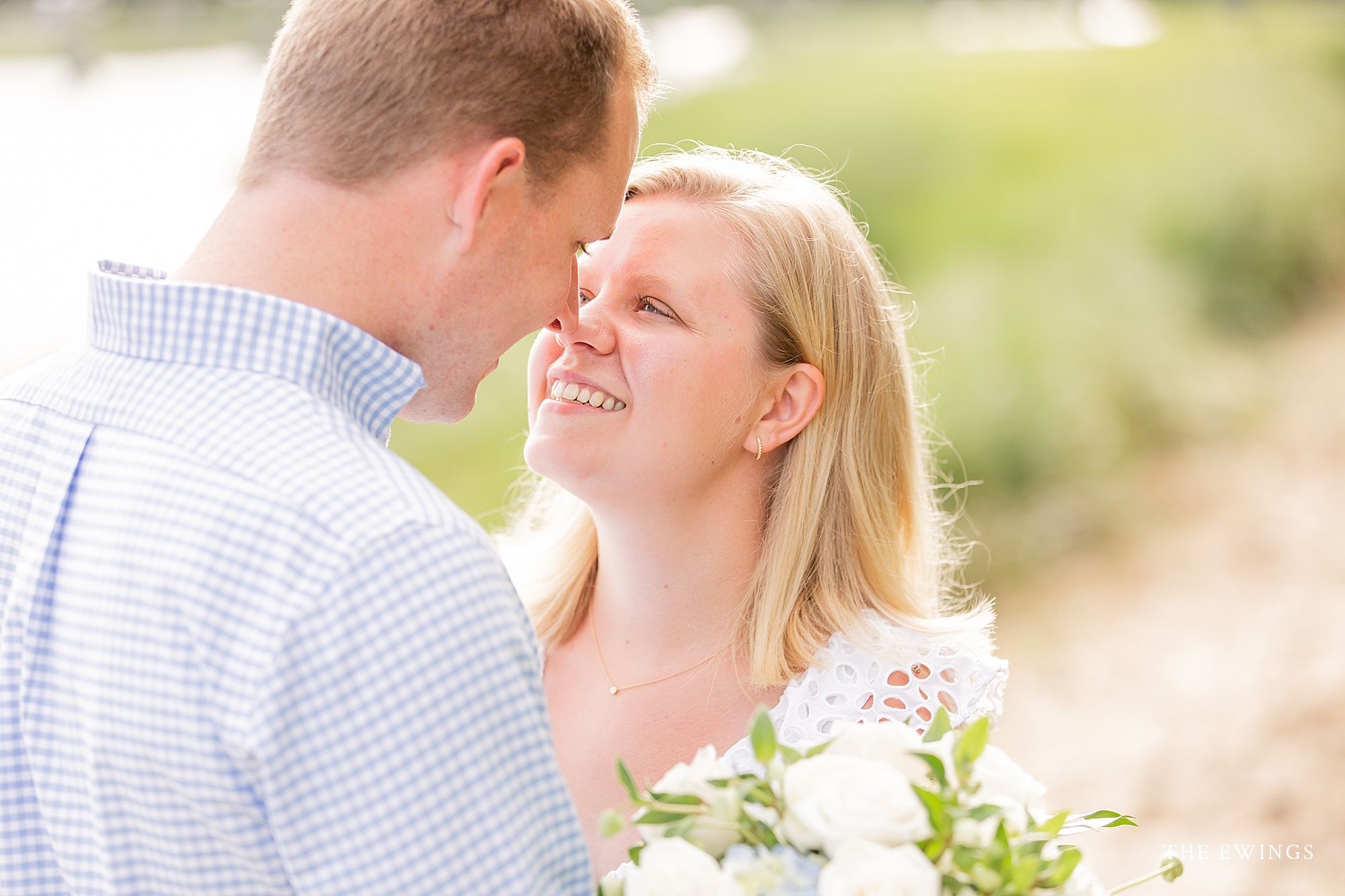 A bride and groom in Cotuit in MA after their Cape Cod elopement wedding ceremony.
