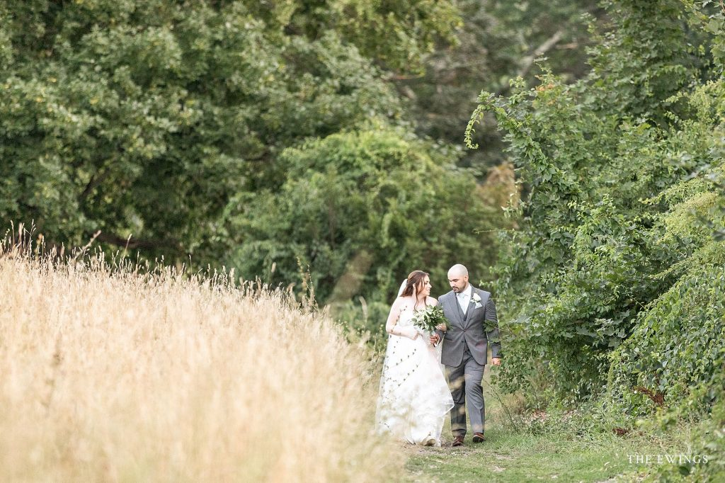 A bride and groom get married in the field overlooking Groton MA in a small elopement with just their parents.