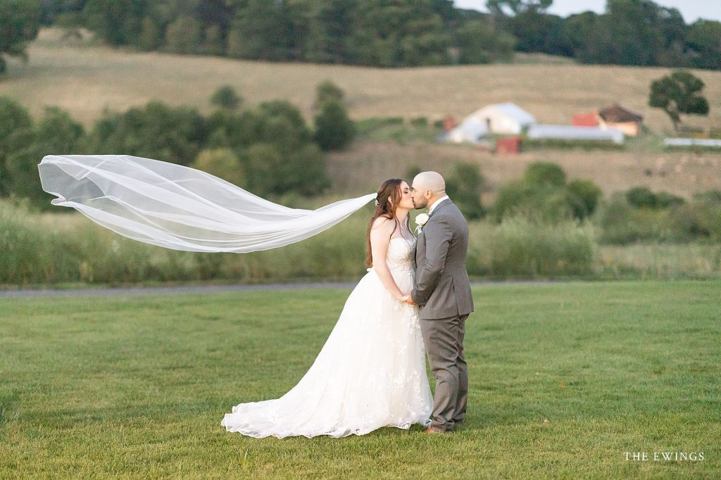 An elopement at Groton Inn's Forge and Vine with rolling countryside backdrop in Massachusetts.