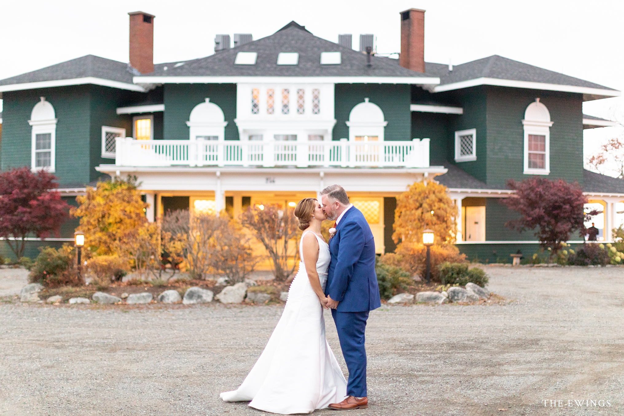 A coastal Maine destination weekend wedding venue at Frenchs Point in Stockton Springs Maine features a cliffside mansion overlooking Penobscot Bay.
