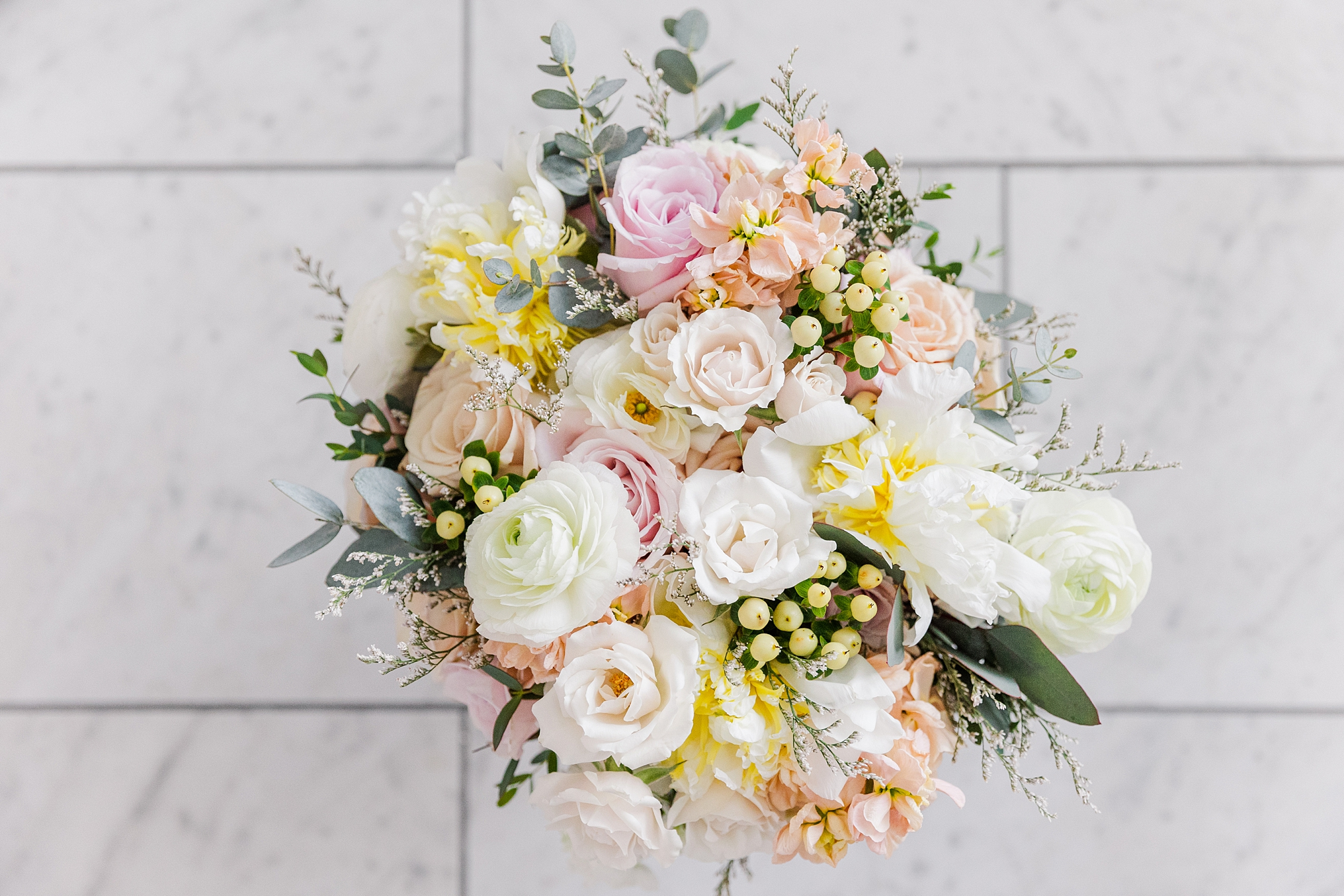A bridal bouquet for a spring wedding by Fucshia Peony in NH.