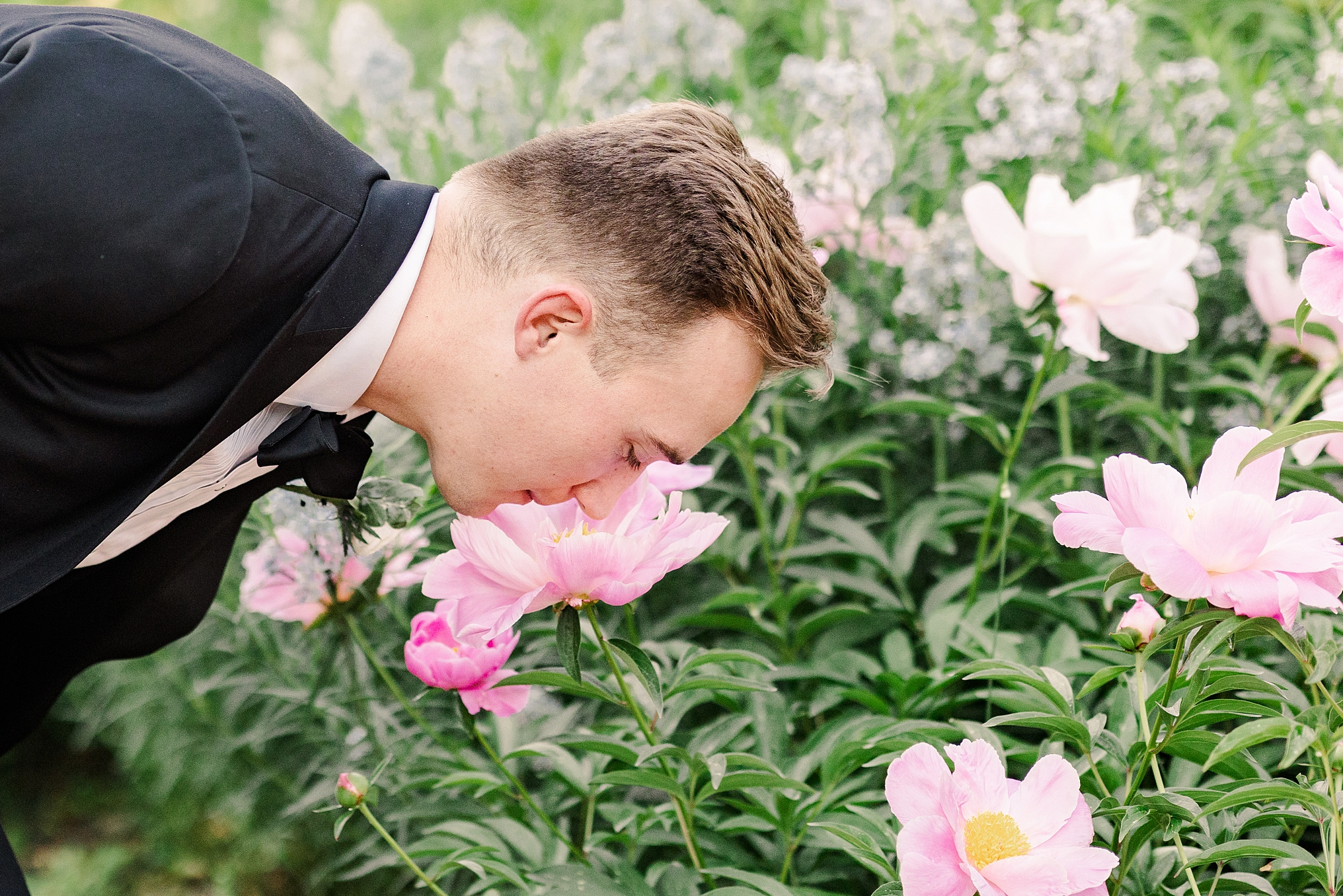 Smelling the beautiful flowers before his wedding reception in Boylston, MA.