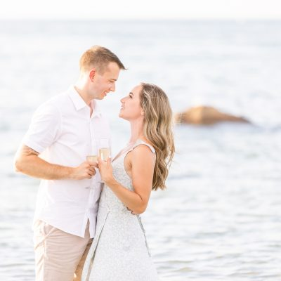 A Gloucester MA beach engagement session that is light and airy in the ocean.